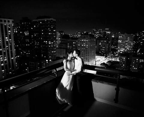 Couple Kissing On Hotel Balcony