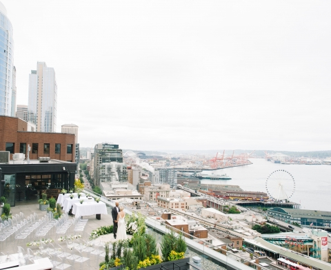 rooftop wedding setup overlooking the water and piers