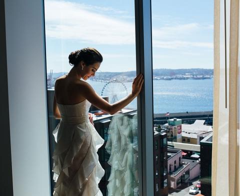 Bride on balcony overlooking Seattle
