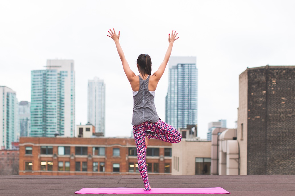 Woman doing Yoga on Rooftop in Pink Pants
