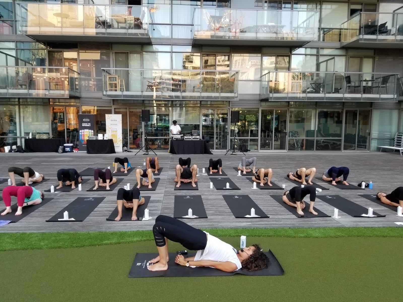 Thompson Toronto Rooftop Yoga with instructor in front